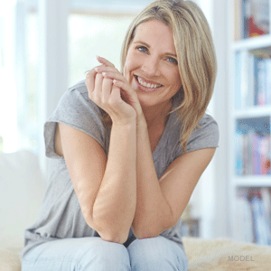 Woman smiling while sitting in her living room