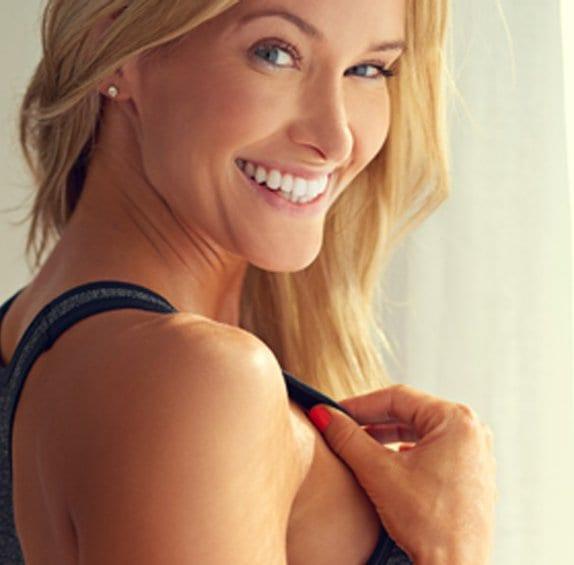 Woman smiling over her shoulder