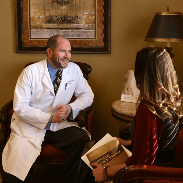 Dr. Freeman consulting with a female patient