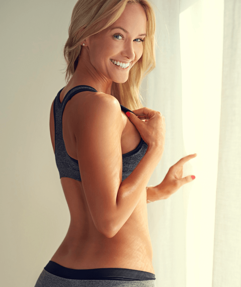 Blonde woman in grey sports bra and shorts