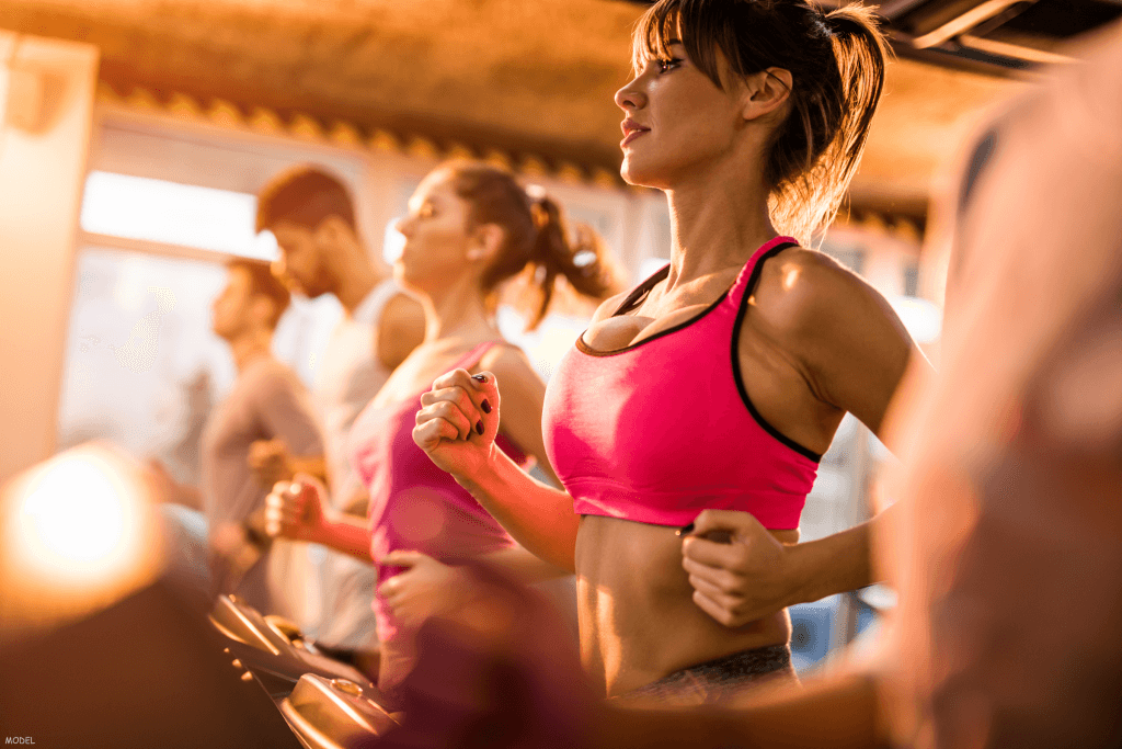 Men and women exercising during a group workout class
