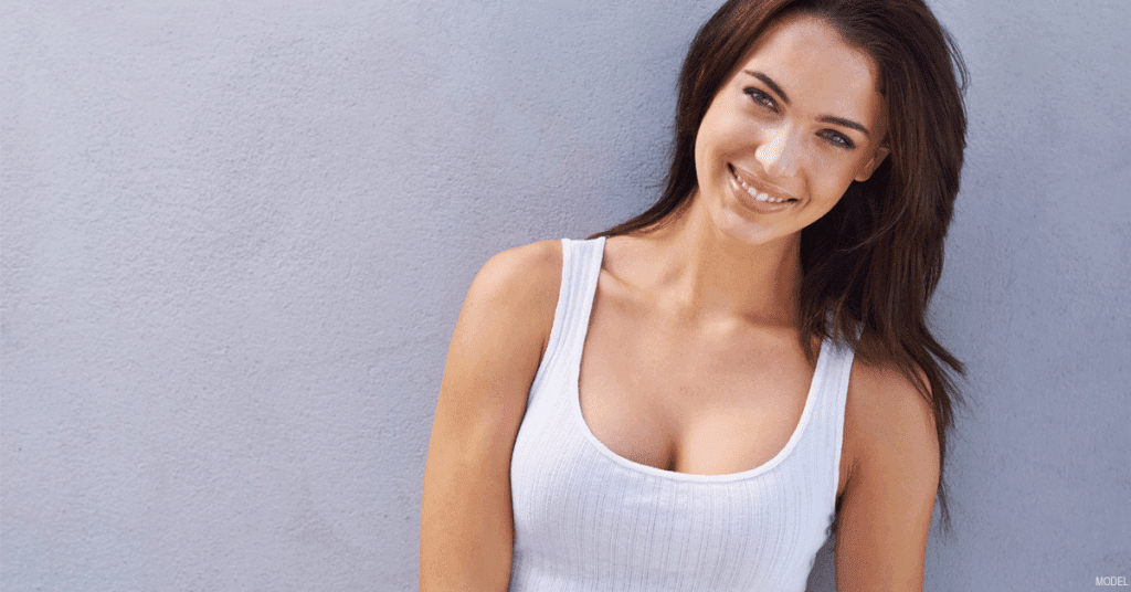 Woman happy with her breast augmentation