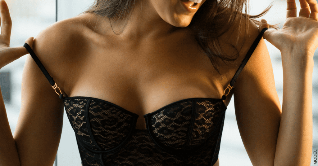 A woman is happy with her breast augmentation results.